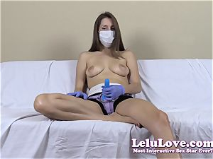stripped to the waist woman with medical mask and strap dildo
