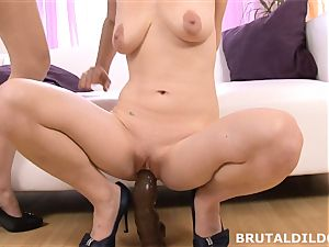 Mary inserts Blue Elis throat and honeypot with a hefty fake penis